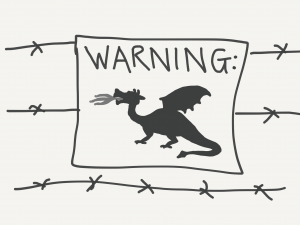 Barbed wire fence with sign: Warning! Dragon!